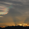 Crepuscular Rays and Iridescent Clouds