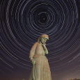 Star Trails Overhead the Statue of Mother